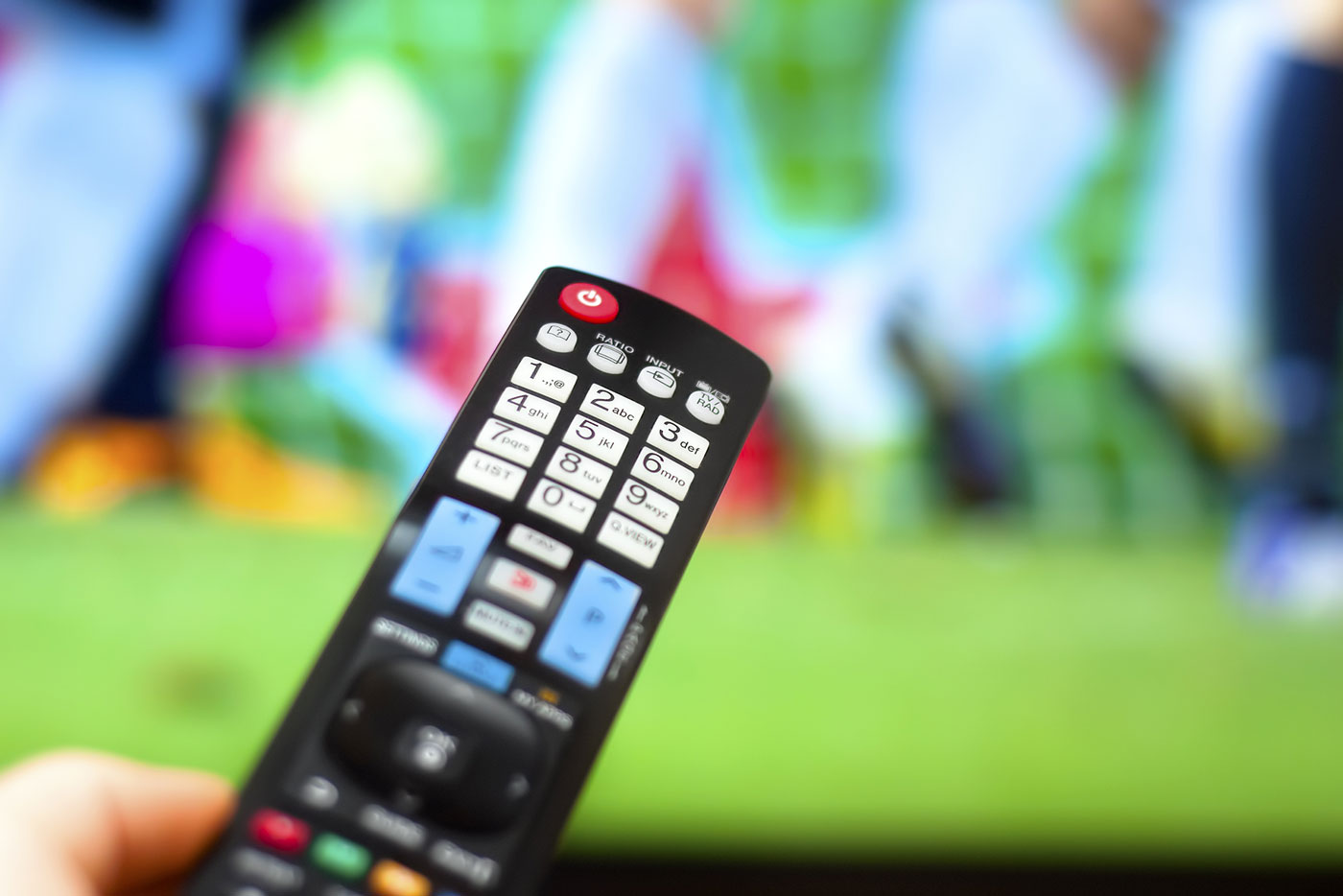 TV remote being used to watch sport